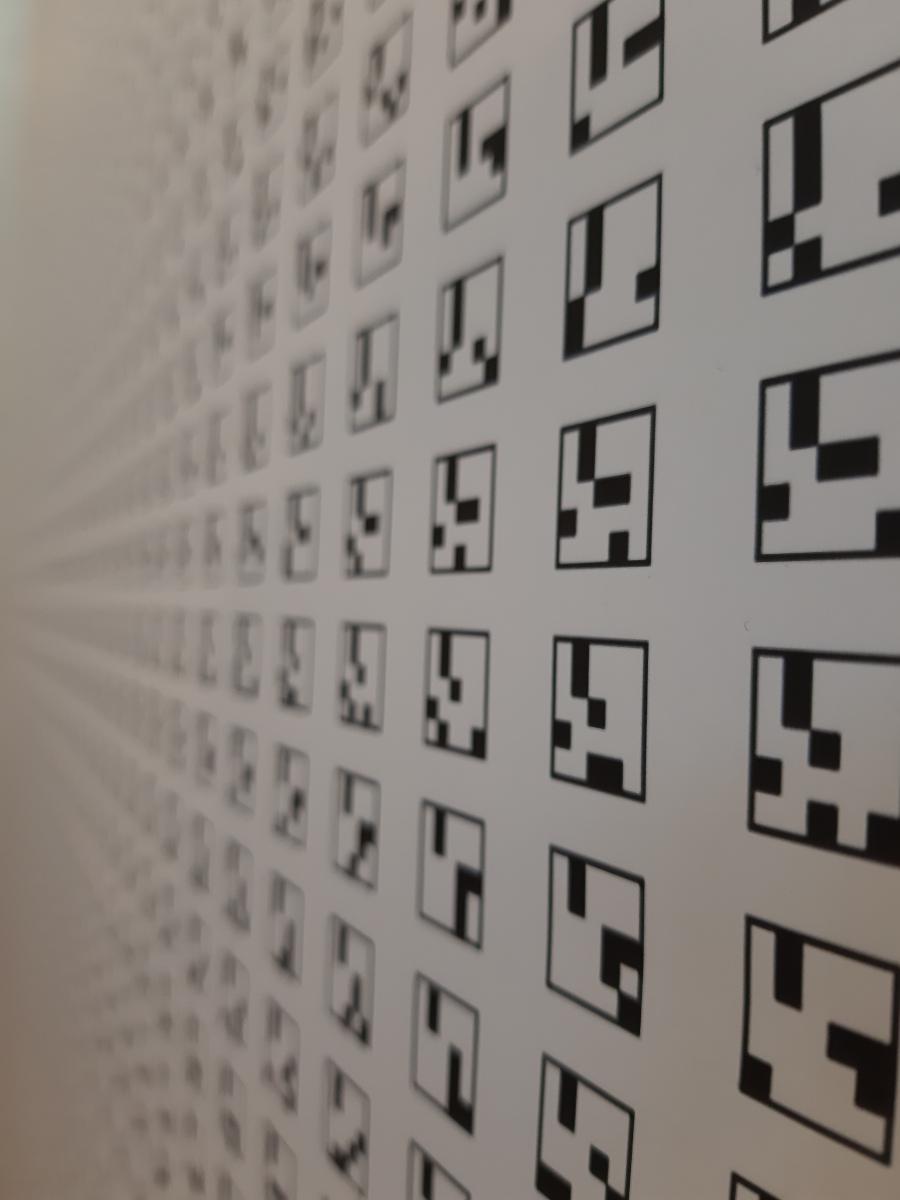 Détail « Bibliothèque d'images de Babel » (2017), une impression générée par ordinateur